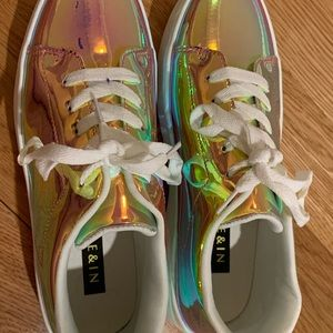 These are some gold holographic sneakers.